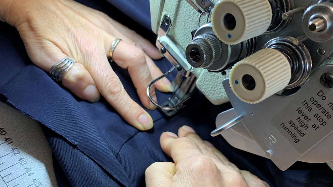 New Plymouth clothing being stitched